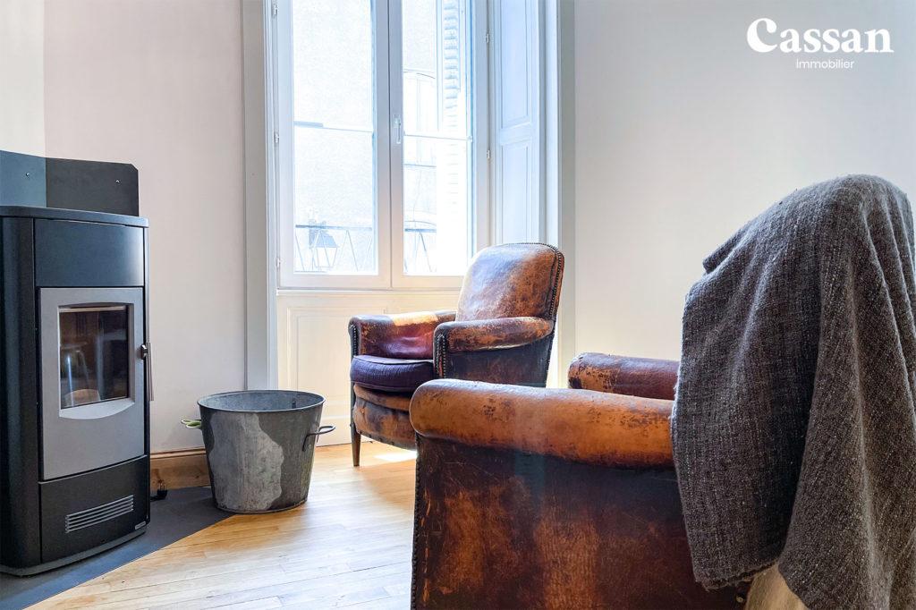 poêle fauteuils club plancher