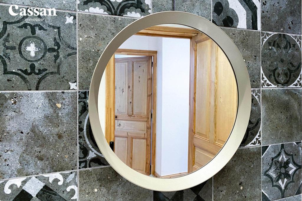 miroir rond carreaux ciment salle de bain